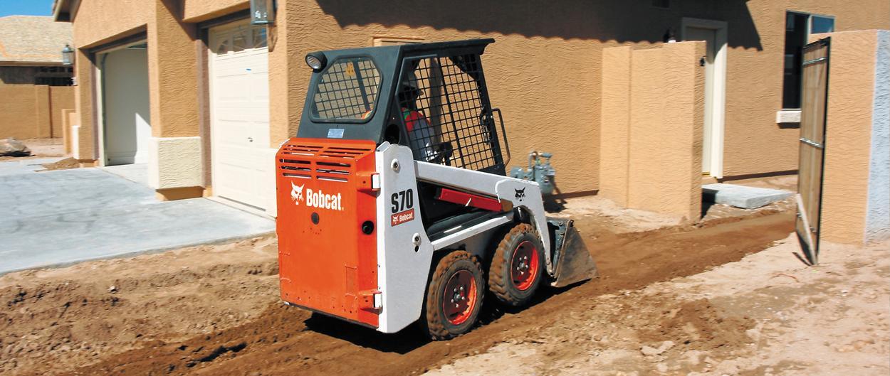 Bobcat S70 skid-steer loader with bucket.