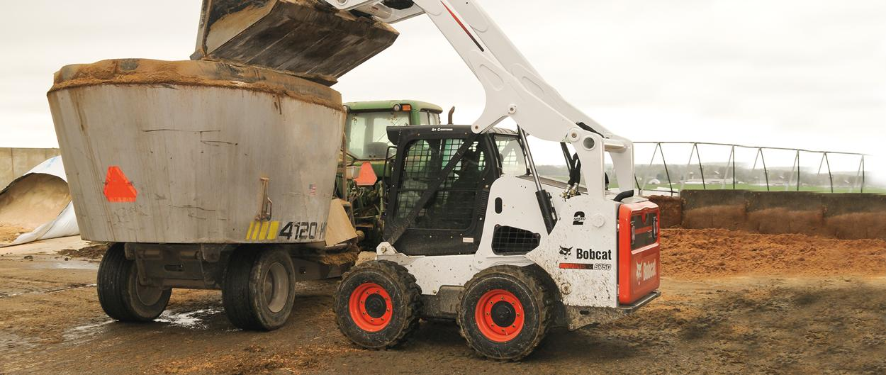 Bobcat S750 skid-steer loader with bucket.
