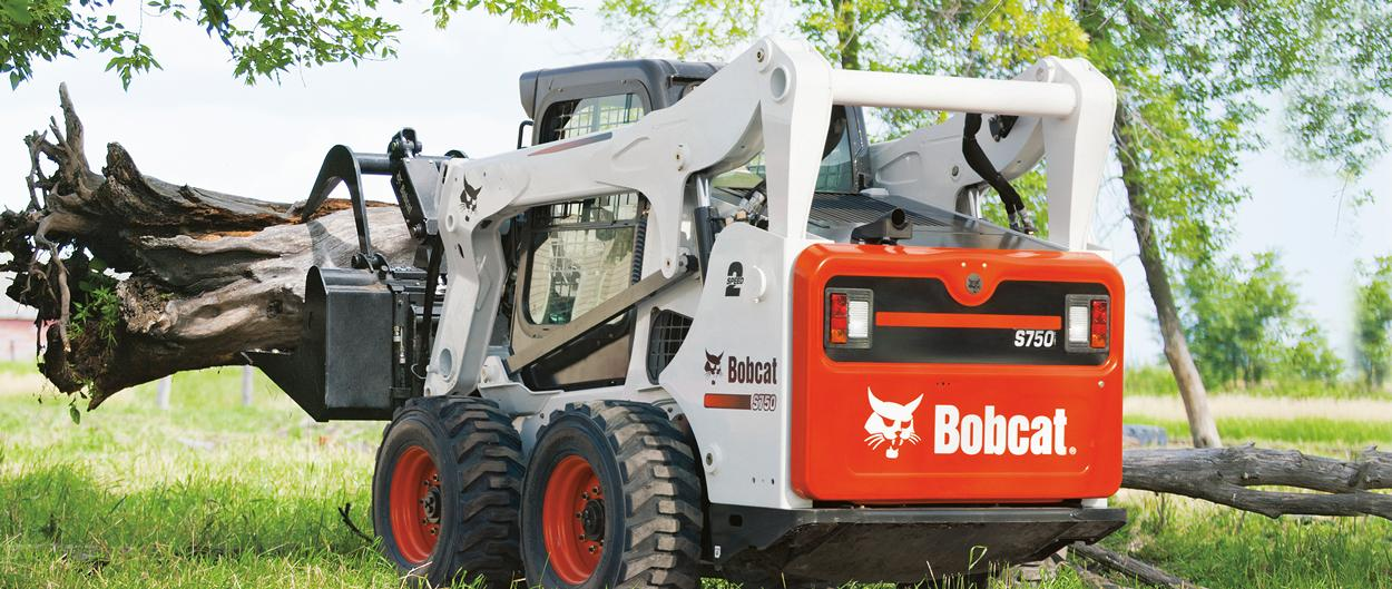 Bobcat S750 skid-steer loader with grapple attachment.