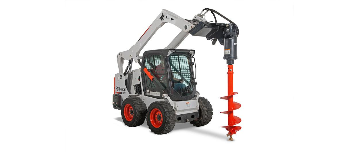 New S595 skid-steer loader with auger attachment