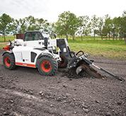 Bobcat V417 VersaHANDLER (telehandler) telescopic tool carrier with trencher attachment.