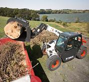 Bobcat V417 VersaHANDLER (telehandler) telescopic tool carrier loads a high truck.