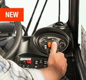 An operator using the joystick inside the VersaHANDLER V519 telehandler.