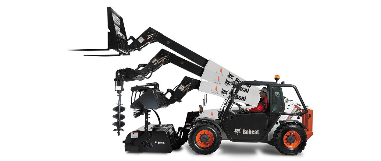 Multiple attachments on the Bobact V417 VersaHANDLER (telehandler) telescopic tool carrier, including a pallet fork, auger, and pallet fork.