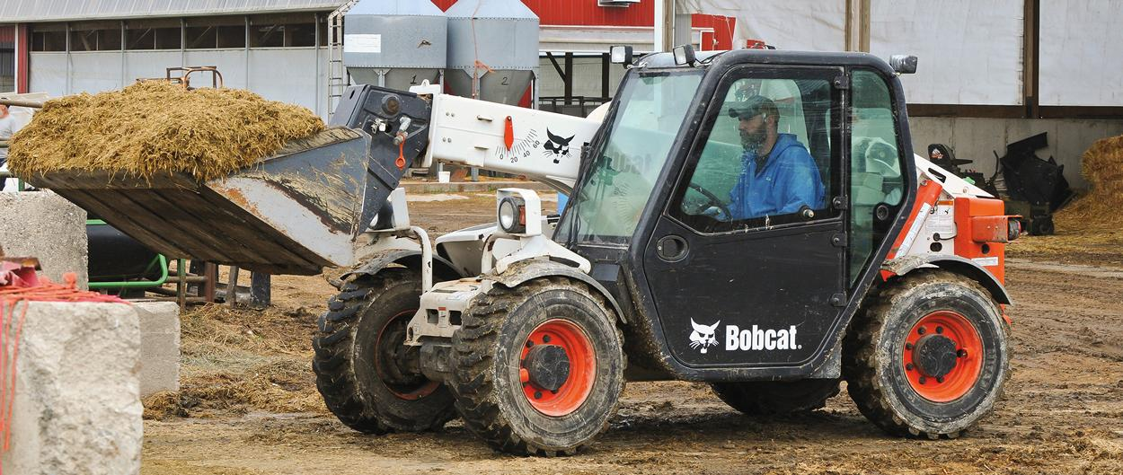A bucket on the Bobcat V417 VersaHANDLER (telehandler) telescopic tool carrier is used to carry silage.