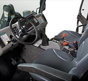 An interior photo shows the control layout of Toolcat utility work machines.