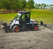 3 pt. tine rake is used with the Toolcat 5610 to prepare soil for planting.