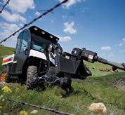 An auger and Toolcat 5600 are used to dig fence post holes.