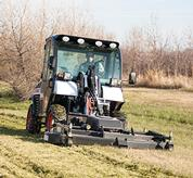A Toolcat 5600 travels at a consistent speed while using a trencher attachment.