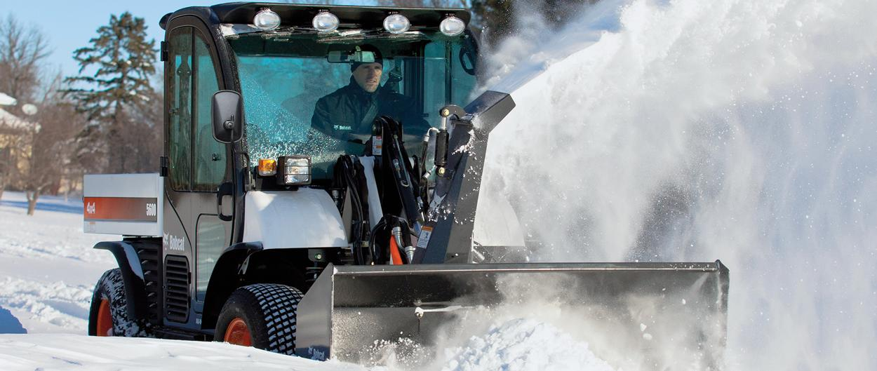 A Bobcat Toolcat 5600 using a snowblower attachment.