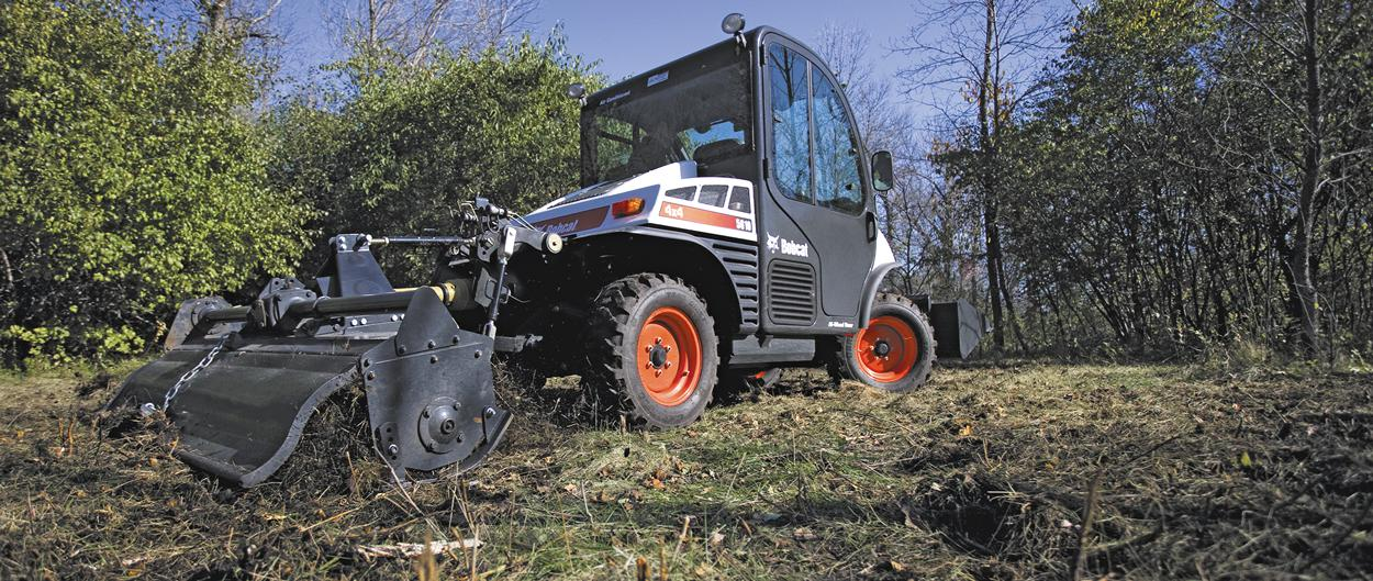 A Toolcat 5610 with a tiller travels at a consistent speed.
