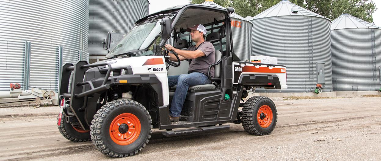 Operator drives Bobcat 3400 utility vehicle (UTV).