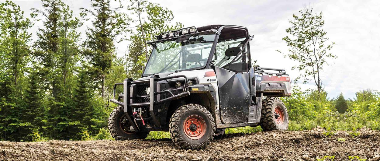 Bobcat 3400 UTV parked on a muddy trail.