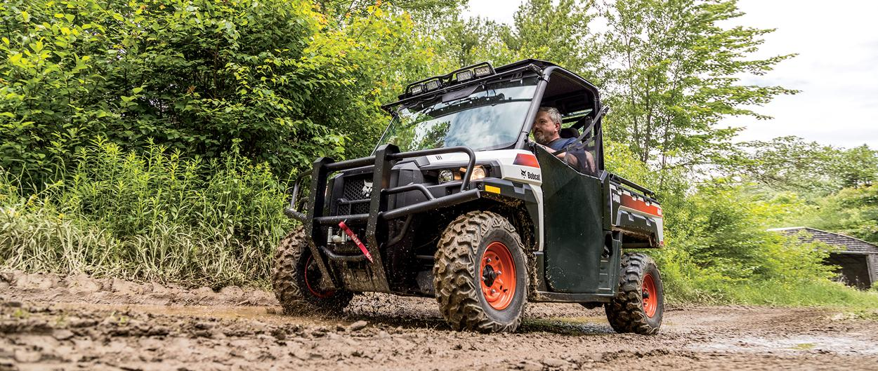 Bobcat 3400 UTV driving on a muddy trail.