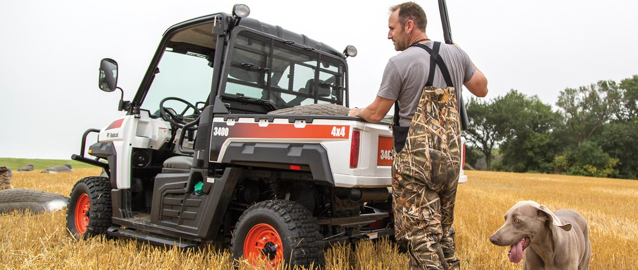 A 3400 Bobcat Utility Vehicle is utilized in a hunting setting.