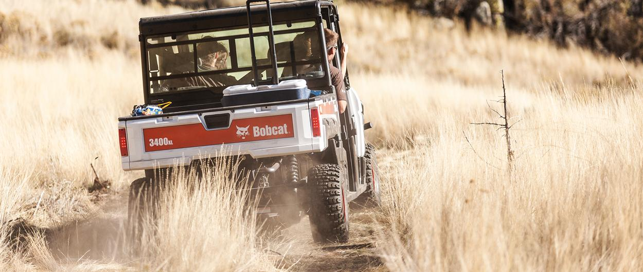 Bobcat 3400XL travels down a trail.