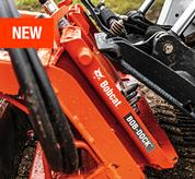 Bobcat compact loader and Bob-Dock attachment mounting system.