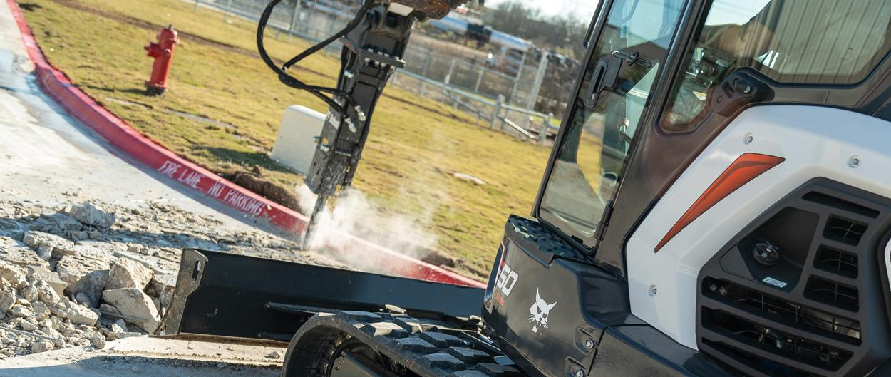 Bbocat E50 Compact Excavator With Nitrogen Breaker Attachement Breaking Up Concrete.
