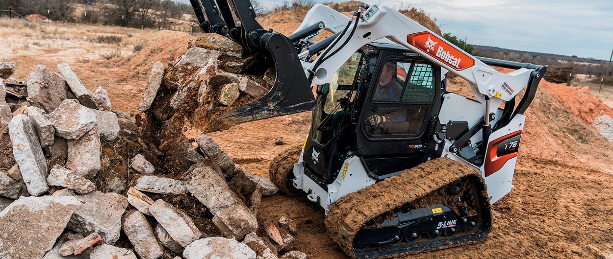 Bobcat R-series Compact Track Loader With Grapple Attachment Moving Rocks