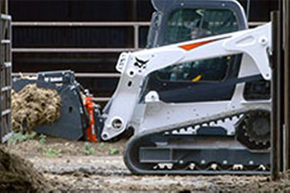 Bobcat T650 compact track loader and Bob-Dock mounting system with industrial grapple.