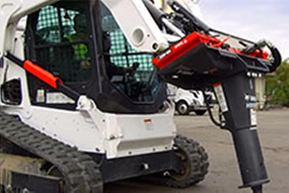 Bobcat T650 compact track loader and Bob-Dock mounting system with breaker.
