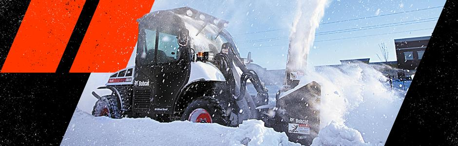 Toolcat Utility Work Machine Removing Snow With Snowblower Attachment