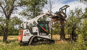 Compact Track Loader Cuts Down Trees With Forestry Cutter Attachment