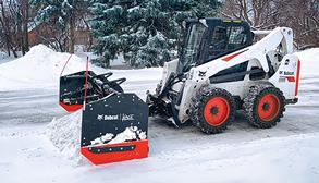 Bobcat Skid-Steer Loader With Snow Attachment Moving Snow