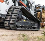 Undercarriage on a Bobcat compact track loader.