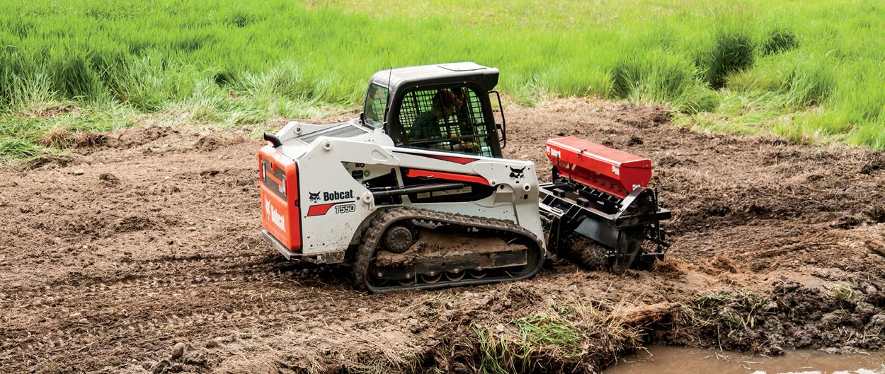 Bobcat T550 compact track loader preparing the soil.