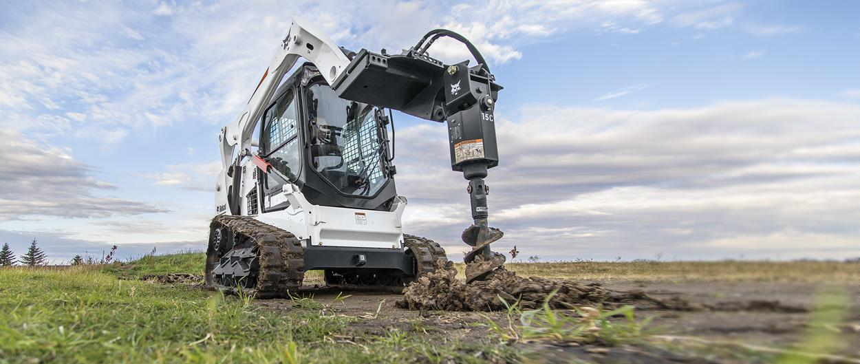 Bobcat T590 compact track loader and auger attachment.