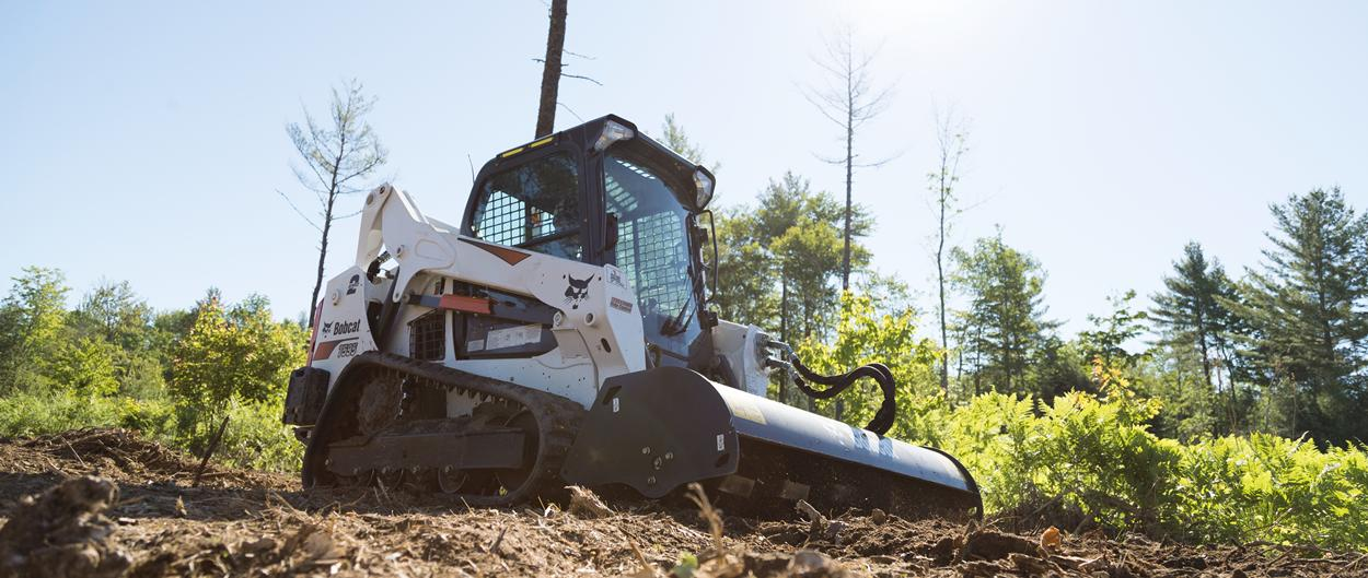 Bobcat T595 compact track loader with tiller attachment.