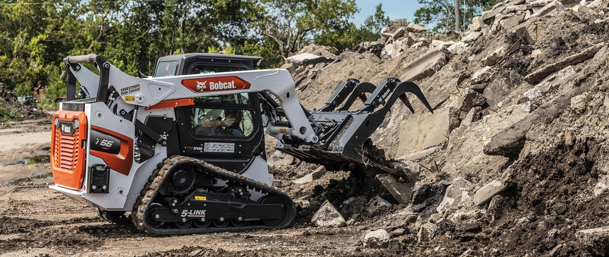 Bobcat T66 Compact Track Loader Using Grapple to Move Construction Debris