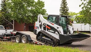 Bobcat T595 compact track loader on a trailer