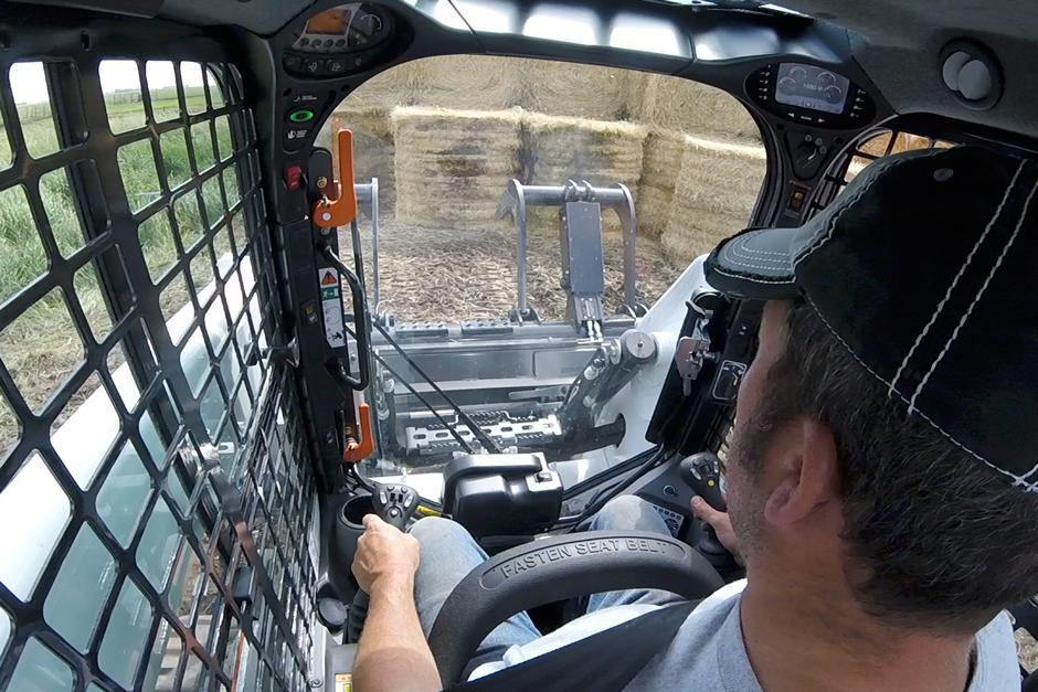 Operator inside Bobcat T870 compact track loader video.