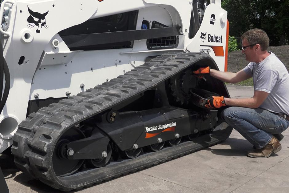 Video of an operator checking the 5-Link torsion suspension undercarriage on a Bobcat compact track loader.