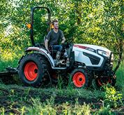Brush Cutter Attachment on a Bobcat Compact Tractor on Farm