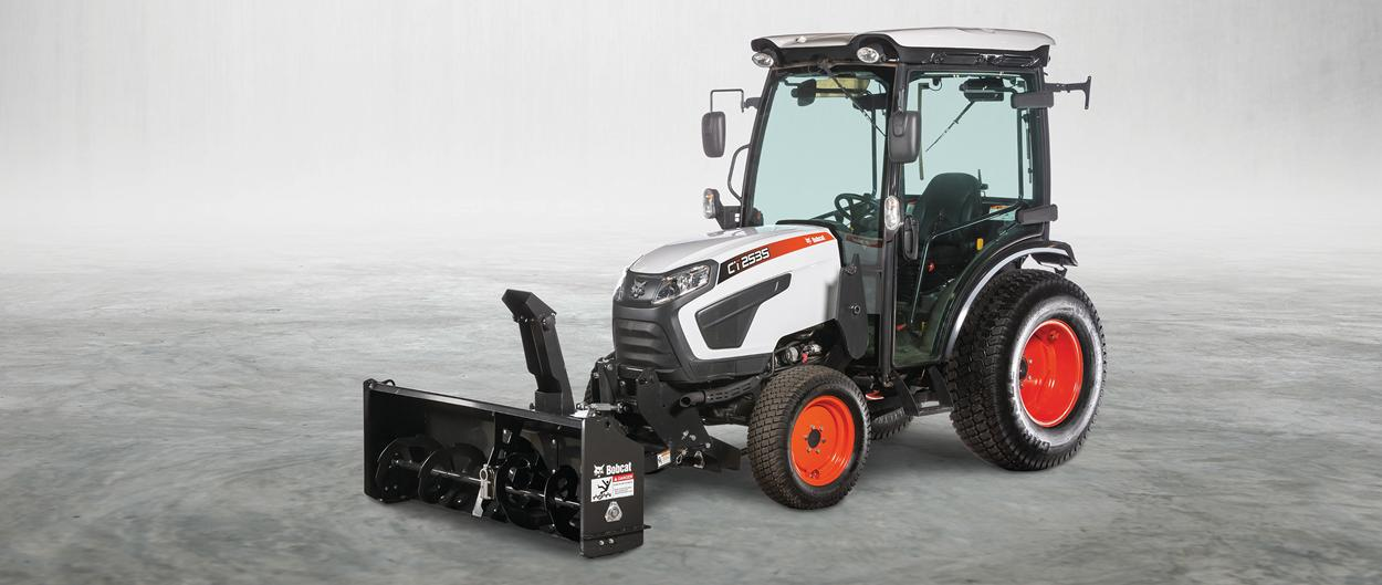Studio Photo Of A Front-End Snowblower Attachment On Bobcat CT2540 Compact Tractor With Enclosed Cab.