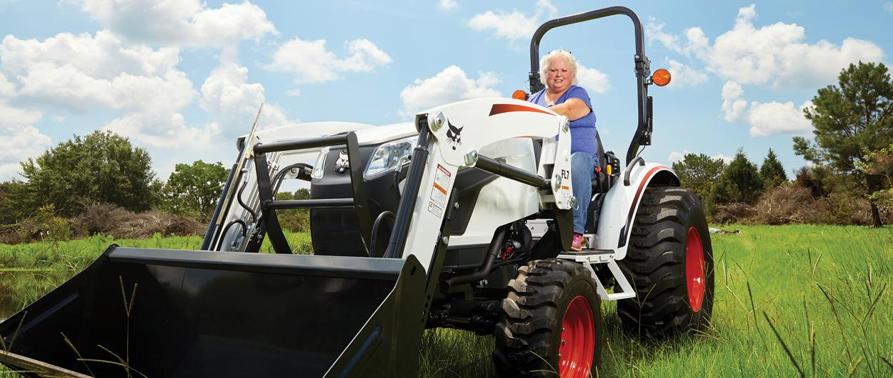 Acreage Owner Behind The Wheel Of A CT2025 Compact Tractor Equipped With A Front End Loader