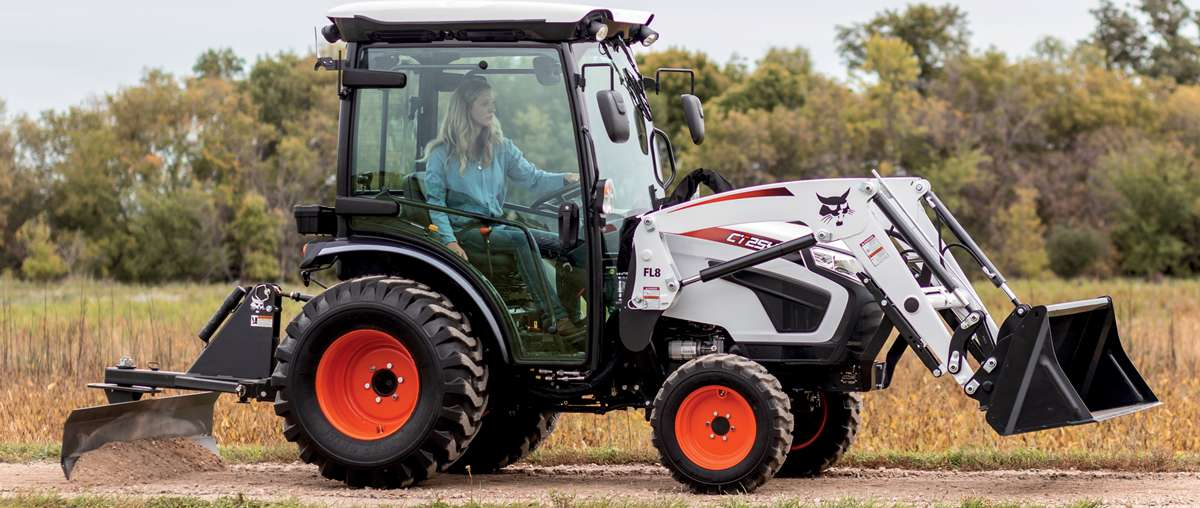 Acreage Owner Operates Bobcat Compact Tractor With Enclosed Tractor Cab And Tractor Attachments