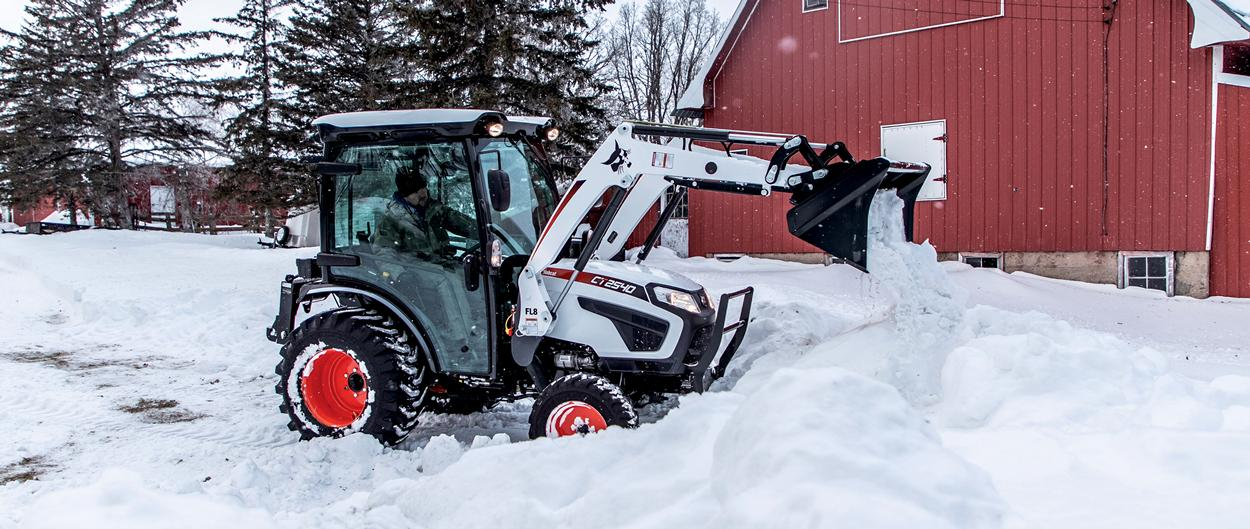 Bobcat CT2540 Compact Tractor Completing Snow Removal With Front-End Loader