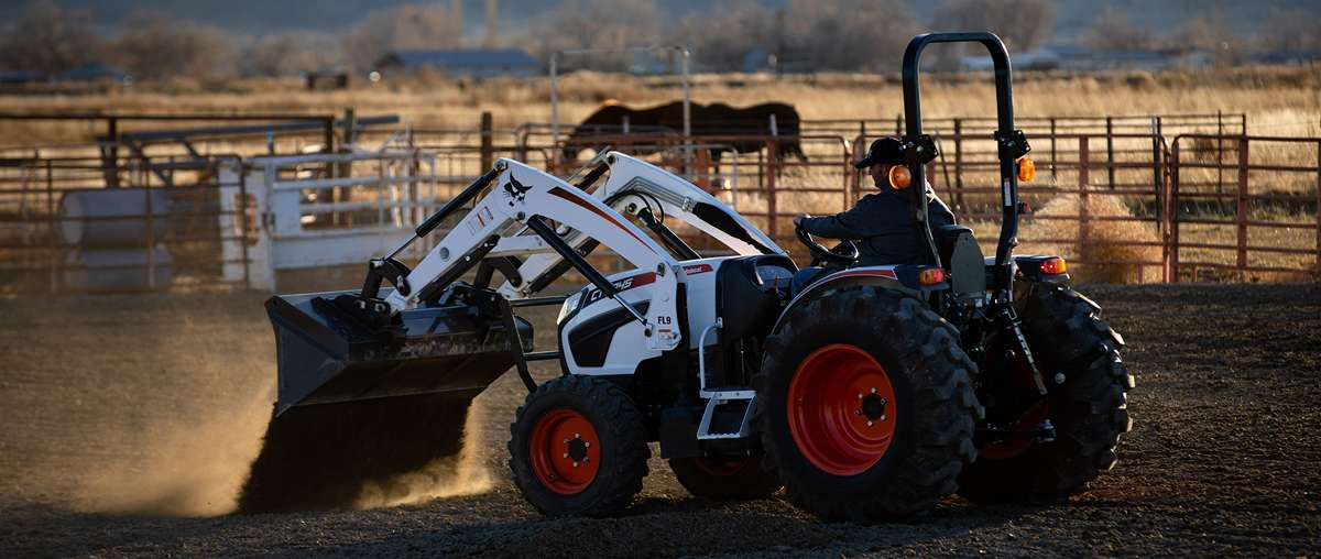 CT4045 Compact Tractor With A Front-End Loader Dumping Dirt Inside Horse Arena