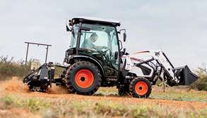 Customer Using Bobcat CT2450 Compact Tractor With Tiller Implement On Acreage