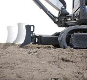 Bobcat compact (mini) excavator blade floating over an obstacle.