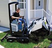 Bobcat compact excavator (mini excavator) with top-mounted boom cylinder.