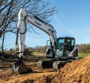 Bobcat 14-16T Size Class Large Excavator Clearing Dirt From Construction Jobsite