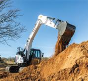 Bobcat 14-16T Size Class Large Excavator Using Powerful Hydraulics To Lift Dirt On Jobsite