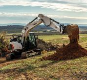 Bobcat 14-16T Size Class Large Excavator Moving Soil On Farm