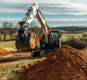 Bobcat 14-16T Size Class Large Excavator Hauling Dirt Using Variable Speed Control
