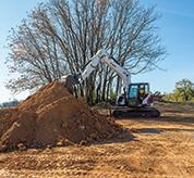 Bobcat 14-16T Size Class Large Excavator Hauling Dirt On Construction Work Site